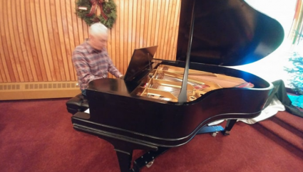 Chris Gillis donates childhood piano to local church