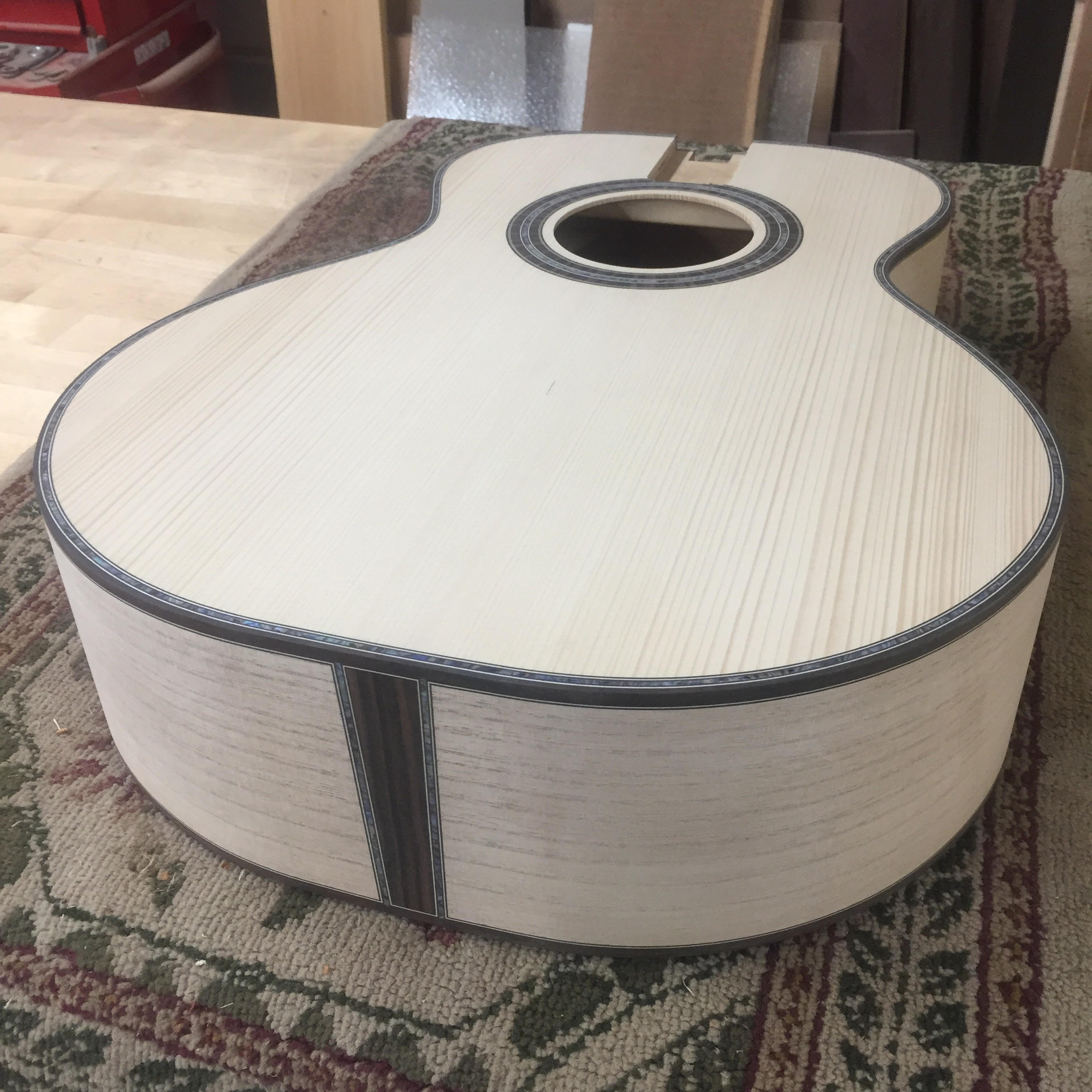 Local luthier Drew Heinonen makes guitar from trees grown by Jimmy Carter